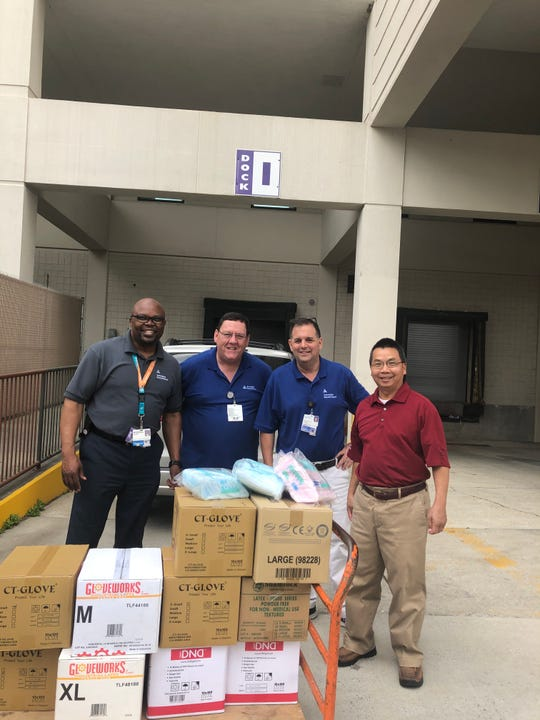 The Pensacola Vietnamese community donated thousands of surgical gloves and masks to both Sacred Heart and Baptist hospitals Monday.