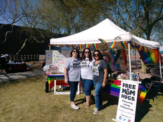 "The nonprofit group ""Free Mom Hugs"" set up a table at the Native PFLAG Two Spirit PowWow at South Mountain Community College on Feb. 29, 2020. The group came up with the idea for Virtual Arizona Pride while strategizing how to bring the community together during a time of isolation."