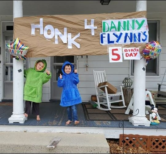 Five-year-old twins Danny and Flynn Michel celebrated their birthday with a car parade after their party was canceled due to coronavirus-related shutdowns.