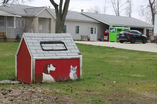 """For people in need of help with dog or cat food, the Humane Society of Ottawa County, 2424 E. Sand Road, Port Clinton, has set up a temporary """"no-contact"""" food bank in the large red doghouse by the street, where people can give or take donated food for pets."""