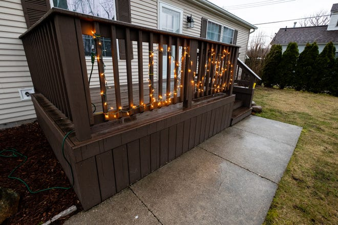 String lights are used to spell the word 'love' on the front porch of a Port Huron home, photographed Monday, March 30, 2020. The lights are part of Operation: Shine Your Light, a Facebook community aimed at spreading joy and hope through light displays.