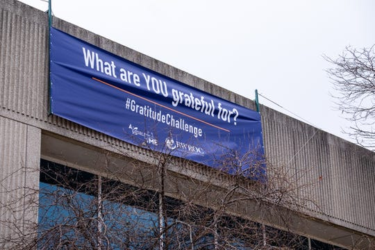 A banner for  the Gratitude Challenge, an online challenge created by A Beautiful Me and BWROC, hangs on the front of the Michigan Mutual building in downtown Port Huron. The challenge encourages people to share photos of things they're grateful for on social media using #gratitudechallenge.