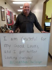 Blue Water Recovery and Outreach Center Recovery Consultant Nino Cinimi holds a sign stating what he is grateful for for the #GratitudeChallenge.