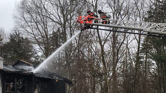 Firefighters respond to a blaze on Chelsea Cove South in Beekman Tuesday morning.