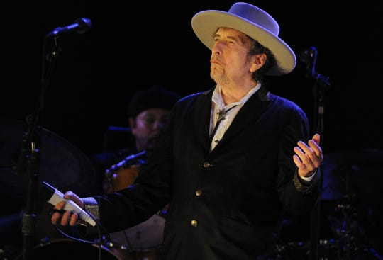 Bob Dylan performs on stage during the 21st edition of the Vieilles Charrues music festival on July 22, 2012 in Carhaix-Plouguer, western France.  AFP