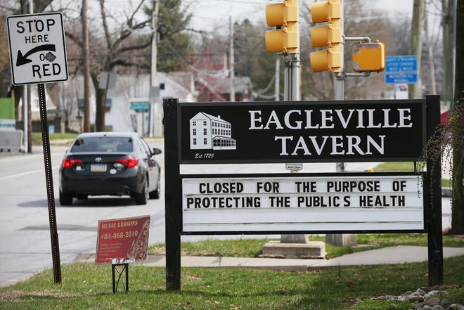 A sign notes that the Eagleville Tavern in Eagleville, Pa., is closed during the ongoing coronavirus pandemic on Wednesday, March 18, 2020. The coronavirus has spread in Montgomery County, leading to a shutdown of nonessential businesses.