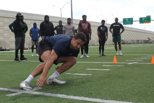 Jan Johnson works on his agility and speed during six weeks of winter training at the Cooper Sports Performance facility in Tampa, Florida. The former Penn State linebacker is preparing for his shot at the NFL.