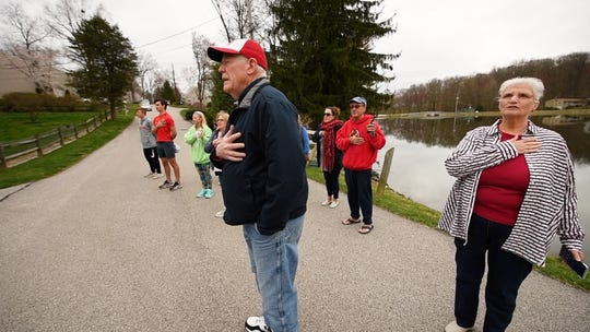 Residents of the Forrest Lakes community, near Shrewsbury, Pa., walk from their houses each morning and gather near a flag pole to recite the Pledge of Allegiance.