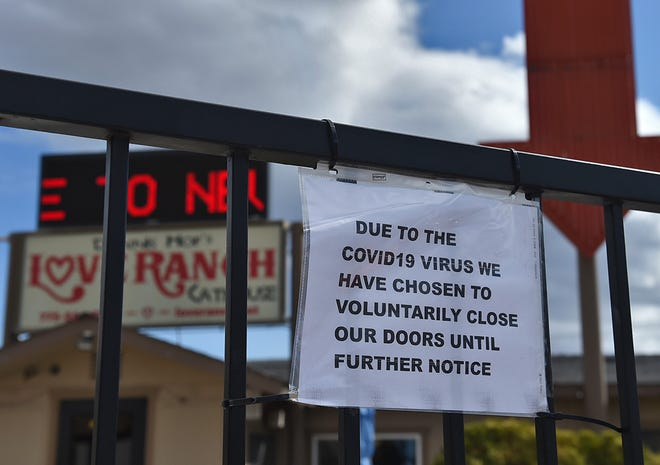 The Love Ranch brothel has a sign posted that says they are voluntarily closed on the front door of the Nevada brothel  on March 30, 2020.
