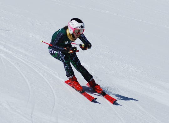 Manogue sohomore Claire Eberle won the girls combined title in the state ski racing racing championships.