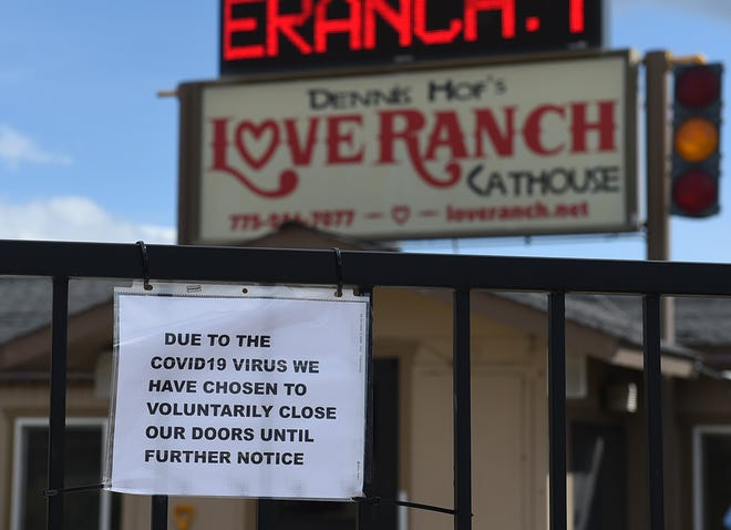 A sign on the front door of the Love Ranch in Mound House, Nevada on March 30, 2020.