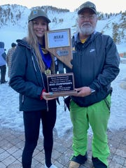 Bishop Manogue sophomore Claire Eberle with Miners ski coach Scott Trabert.