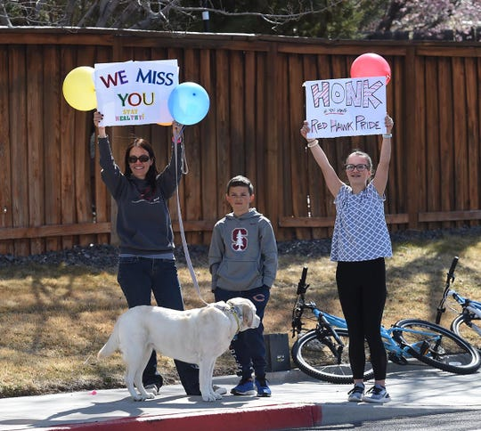 Van Gorder Elementary teachers and staff have a car parade through the surrounding neighborhood to try and stay connected with students and families during COVID-19 shut down on March 31, 2020.