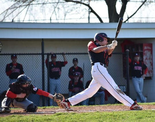 Hilton's Jason Story takes a swing during a game last season. Story was a second-team All-County selection for the Cadets but his senior season is on hold due to coronavirus.