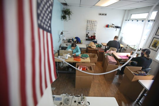The workforce at the Rochester Refugee Sewing & Repair shop on Dewey Ave. in Rochester are hard at work filling orders for masks Tuesday, March 31, 2020. The shop is working to make thousands of face masks, and gowns to fill orders that have been coming in since the coronavirus outbreak started.