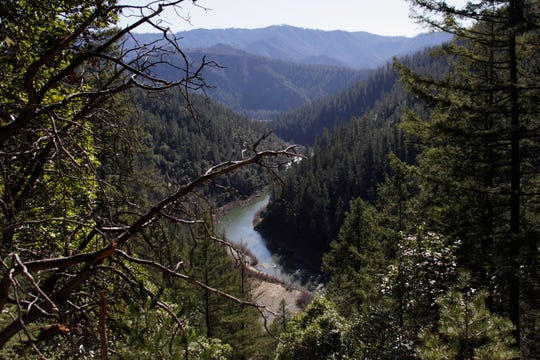 In this photo taken March 3, 2020, the Klamath River is seen flowing across northern California from atop Cade Mountain in the Klamath National Forest. A plan to demolish four dams on California's second-largest river to benefit threatened salmon has sharpened a decades-old dispute over who has the biggest claim to the river's life-giving waters. The project, if it goes forward, would be the largest dam demolition project in U.S. history and reopen 400 stream miles of potential salmon habitat that's been blocked off for more than a century. Numerous tribes in southern Oregon and northern California are pushing for the dams' removal to save dwindling salmon populations in California's second-largest river. (AP Photo/Gillian Flaccus)