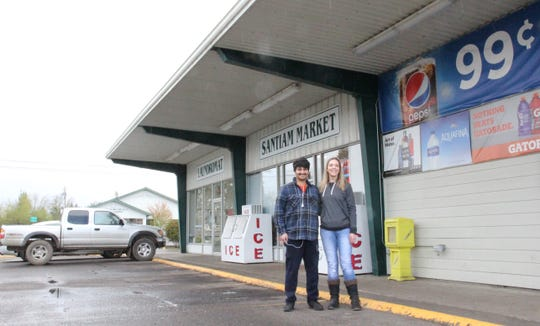 Santiam Market and Jefferson Laundromat owners Megan Schuster and Gunaji Kolekar stand in front of their stores. After seeing a need in their community due to the COVID-19 pandemic, they started JeffersonDelivers.com for small businesses in their city to deliver food and supplies.