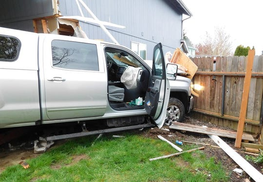 A Salem man is charged with DUI after police say he drove his pickup truck into the back of a Keizer home on Saturday, March 28.