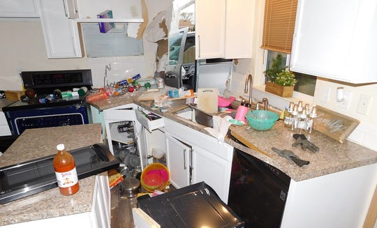 The inside of a Keizer kitchen after a man crashed his pickup through a fence and into the back corner of the home Saturday, March 28.