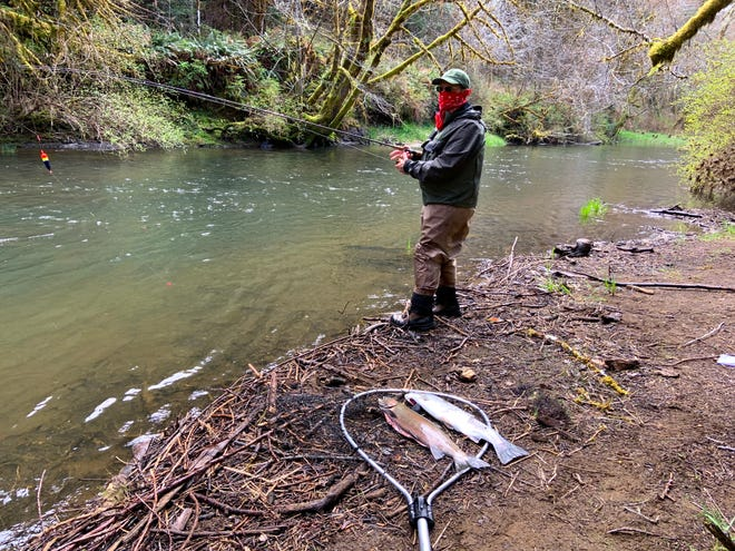 Henry Hughes fishes along a Coast Range River amid the COVID-19 outbreak.