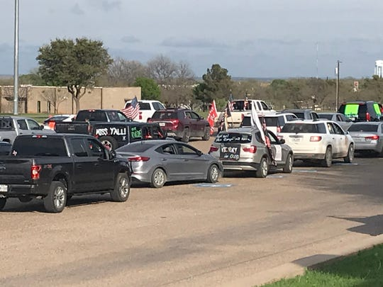 Cars of Ballinger ISD employees fill the high school parking lot before they begin a parade through town Monday, March 30, 2020, due to students now missing a third straight week of scheduled classes because of the coronavirus pandemic.