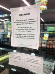 "Facebook user Kristen Rudisill posted an image of a sign on the egg case in a Salisbury Food Lion March 31, 2020. The sign says, ""Due to limited supply and higher than usual demand, our suppliers have increased their prices on eggs. As a result, you may see higher prices, as well as potential interruptions in supply. We apologize for the inconvenience and will do our best to keep items in stock at the best prices possible."" The store asks customers to take no more than two."