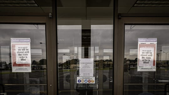 Closed signs in the front doors of Gordman's in Onley.