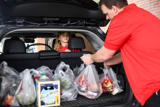 Hy-Vee customers opt for grocery pick-up services during the coronavirus pandemic on Tuesday, March 31, 2020 at Hy-Vee in Sioux Falls, S.D.