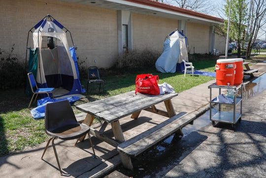 A pair of camp showers have been set up outside of the Veteran's Coming Home Center on Jefferson Avenue to provide the homeless a place to shower.