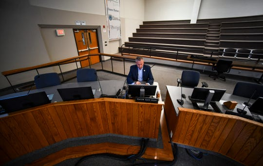 St. Cloud Mayor Dave Kleis is all alone in the city council chambers as he takes part in the city council meeting thought videoconferencing Monday, March 30, 2020, in St. Cloud.