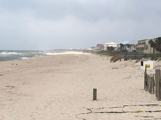 The beaches at St. George Island are empty after the county ordered the close as communities try to stop the spread of the deadly coronavirus.