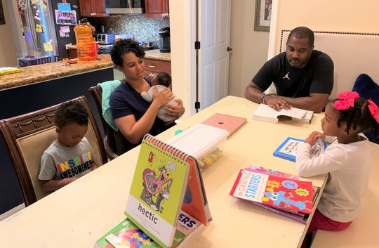 FAMU football head coach Willie Simmons and his wife Shaia lead a homeschooling lesson with their children Shailoh (right) and Wraylon.