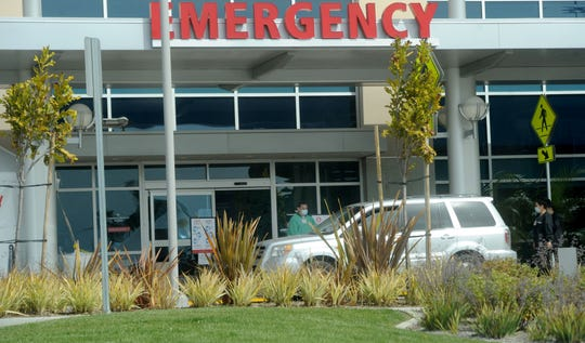 Medical personnel from Community Memorial Hospital screen people in their cars Tuesday, March 31, 2020, as concerns about the coronavirus continue.