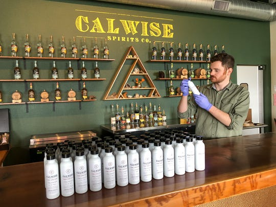 Aaron Bergh of Calwise Spirits Co. in Paso Robles is using his distillery to make sanitizer for law enforcement agencies, including the Ventura County Sheriff's Office, due to coronavirus-related shortages.