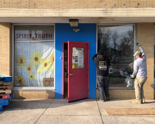 A South Jersey Glass & Door crew replace a window at the Vineland Soup Kitchen office on East Landis Avenue that was damaged by a vandal over the weekend. The glass and labor were donated by the Vineland company.