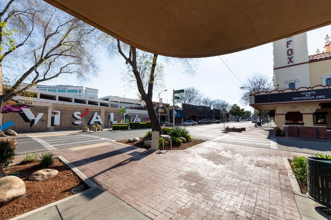 Empty crosswalks and sidewalks are the new norm in Downtown Visalia on Monday, March 30, 2020.