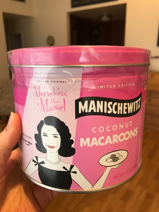 "Spice up your Passover seder with a limited edition Manischewitz ""Marvelous Mrs. Maisel"" tin of coconut macaroons."