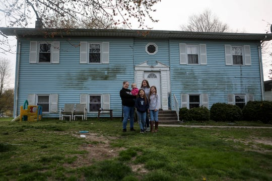 Amber Thornley poses in front of her Felton home with children, Westyn, Anjel, Serenity and Temperance. Thornley is 34-weeks pregnant with her fifth child and scared to give birth during the coronavirus pandemic.