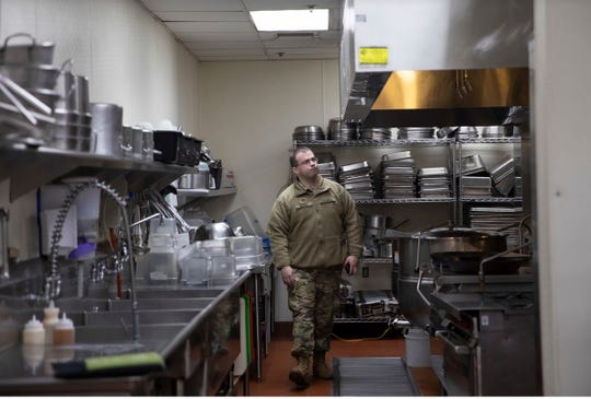 Capt. Joseph Kupina, Delaware National Guard Medical Officer assisting Delaware Emergency of Management Agency (DEMA), inspects the kitchen of one of the facilities the state said can serve as an alternate care facility in case state hospitals become overwhelmed by the pandemic.
