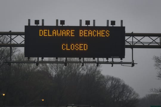 A sign hangs above the I-95 in Delaware on Monday, March 30, warning travelers that the state's beaches are closed.