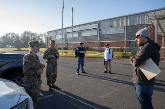State and military agencies gather outside Dover's Modern Maturity Center, one of the sites the state said can serve as an alternate care facility in case state hospitals become overwhelmed by the pandemic.