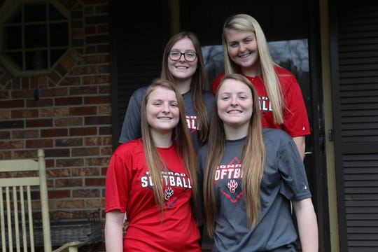 Quadruplets, Cassidy, Abigail, Kailee and Emma Dodds, pose on the porch of their Hockessin home. Their senior year at Conrad has been disrupted by the COVID-19 pandemic.