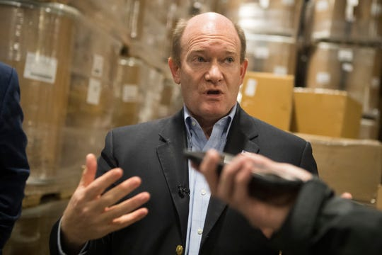 Sen. Chris Coons speaks to the media about the arrival of nearly 500,000 disposable face masks Tuesday morning at D&S Wharehousing Inc in Newark.