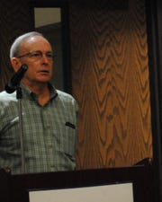 Steve Smith, co-owner of Smith's Gardentown, speaks Tuesday morning at a city council meeting. Under the shelter in place order, Smith's could not be open to the public. The order would only the sale of plants by phone or online and the plants would have to be delivered to the customer.
