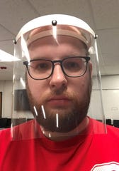 Jarvis Huck, a STEM instructor at Shenandoah, shows off one of his face shields he created with a 3-D printer. He wants to produce these masks to assist medical personnel during the coronavirus pandemic.