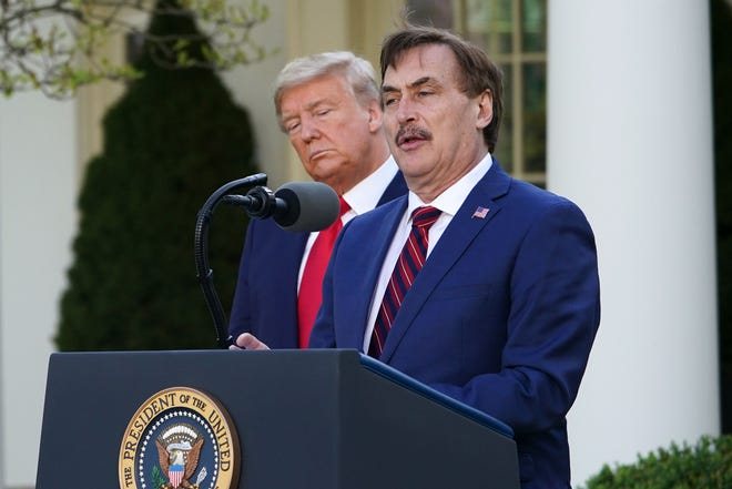 President Donald Trump listens to Michael Lindell, CEO of MyPillow Inc., in the White House Rose Garden on March 30, 2020.