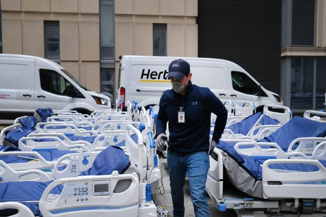 Workers prepare dozens of extra medical beds as they are delivered to Mount Sinai Hospital amid the coronavirus pandemic on March 31, 2020 in New York City. Hospitals in New York City, the nation's current epicenter of the COVID-19 outbreak, are facing shortages of beds, ventilators and protective equipment for medical staff.