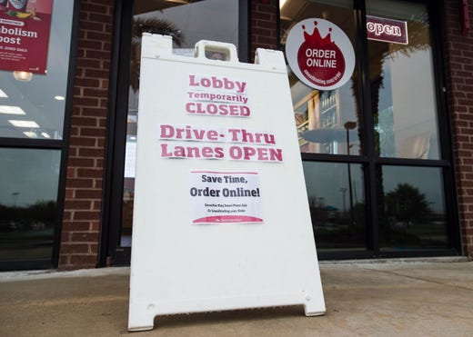 Smoothie King lobby in Lafayette, La. is temporarily closed, drive thru is still open. Local business coping with restrictions to comply with new rules aimed at reducing the spread of COVID-19 in Louisiana. The restrictions designed to reduce social gatherings by limiting the size of gatherings to fewer than 50 people, closing casinos, bars and movie theaters and limiting restaurants to delivery, take out and drive-through orders only on Tuesday, March 17, 2020.