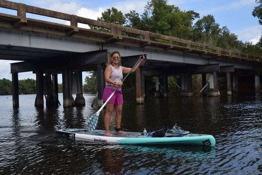 Jessica Difulco (pictured) and husband Luke Difulco recently purchased River Paddle Rentals, a paddle board and kayak rental business, from James and Karen Waight.