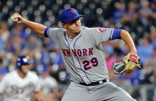 New York Mets relief pitcher Brad Brach (29) pitches against the Kansas City Royals during the eighth inning at Kauffman Stadium last season.